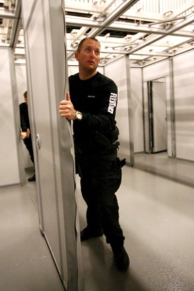 Hufcor FlexTact movable walls during a non-lethal police training exercise at a shoot house