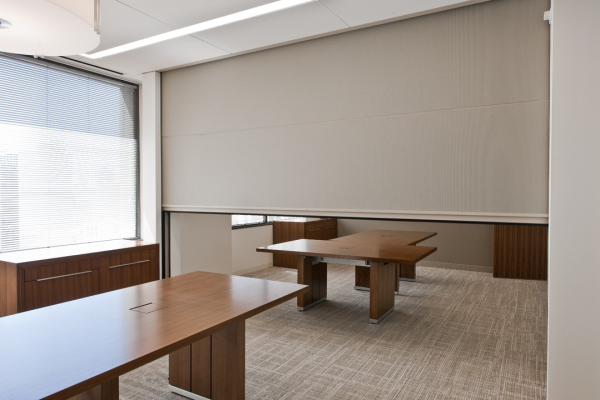 Retractable partition walls automatically stack vertically above the ceiling by push of a button