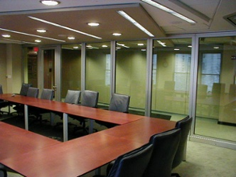 Financial services installed acoustical glass wall providing functionality and showing off interior designs of adjacent rooms