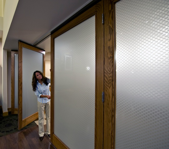 Timber framed glass wall panel system with rich wood design demonstrating convenience of paired panels in wood
