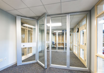 Example of office environment with acoustically rated glass folding doors inside of a school