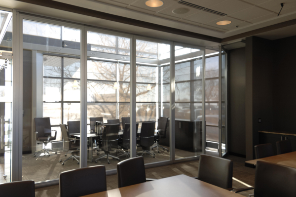 Image of corporate office setting using acoustic glass movable walls in LEED certified building