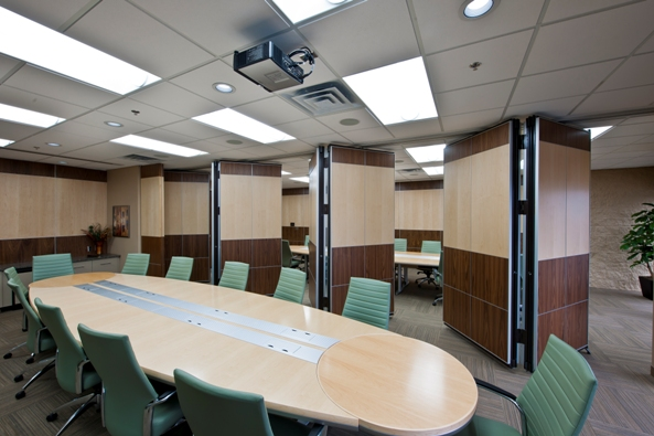Photo example of paired operable wall folding panels designed to be a divider for a conference room