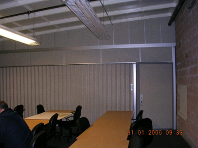 Photo that demonstrates how Unispan overhead tracks can support accordion doors as well as movable walls