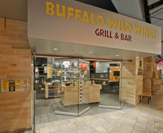 Frameless movable glass walls outside of restaurant storefront at Buffalo Wild Wings Grill & Bar