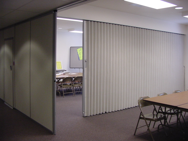Accordion doors or concertina doors example of inexpensive walls to quickly and efficiently separate a room